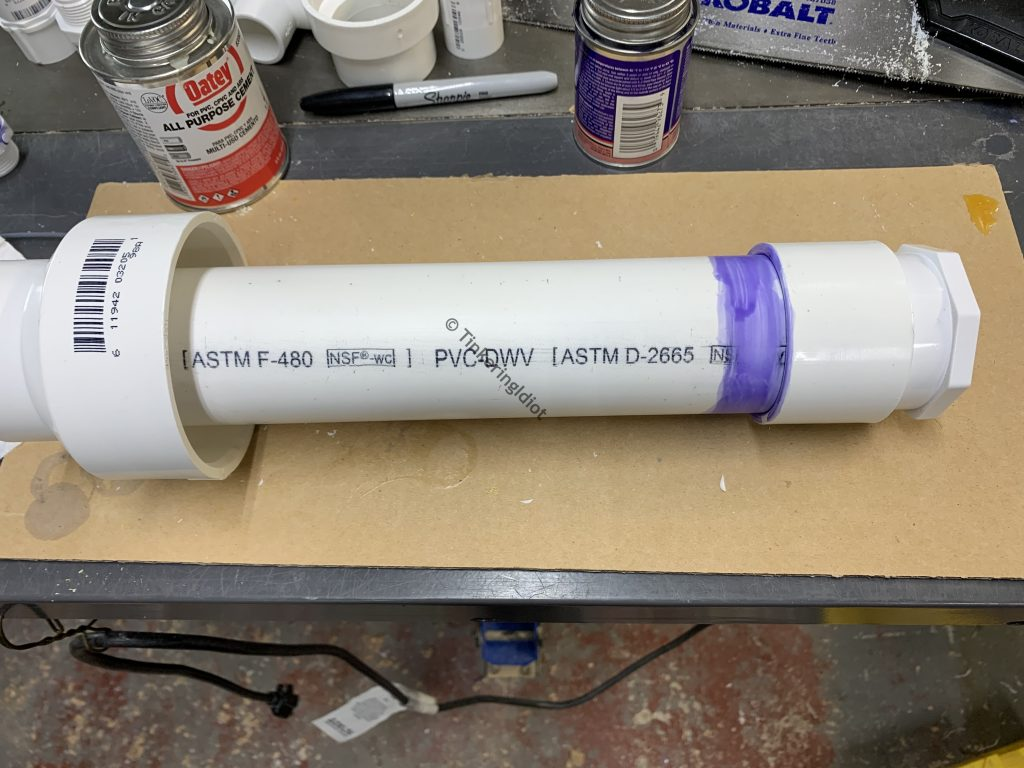 gluing the larger reducer on to the pump body by sliding it down over the top