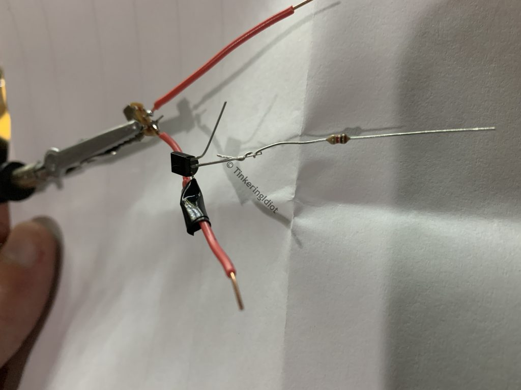 adding a resistor to the transistors base pin